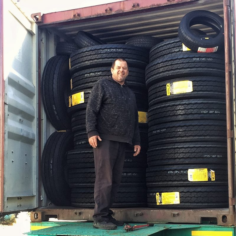 David unloading a full container of GT Radial tires